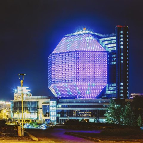 Minsk, Belarus - September 28, 2014: Unique Building Of National Library Of Belarus In Minsk At Night Scene. Building Has 23 Floors And Is 72-metre High. Library can seat about 2,000 readers and features a 500-seat conference hall.